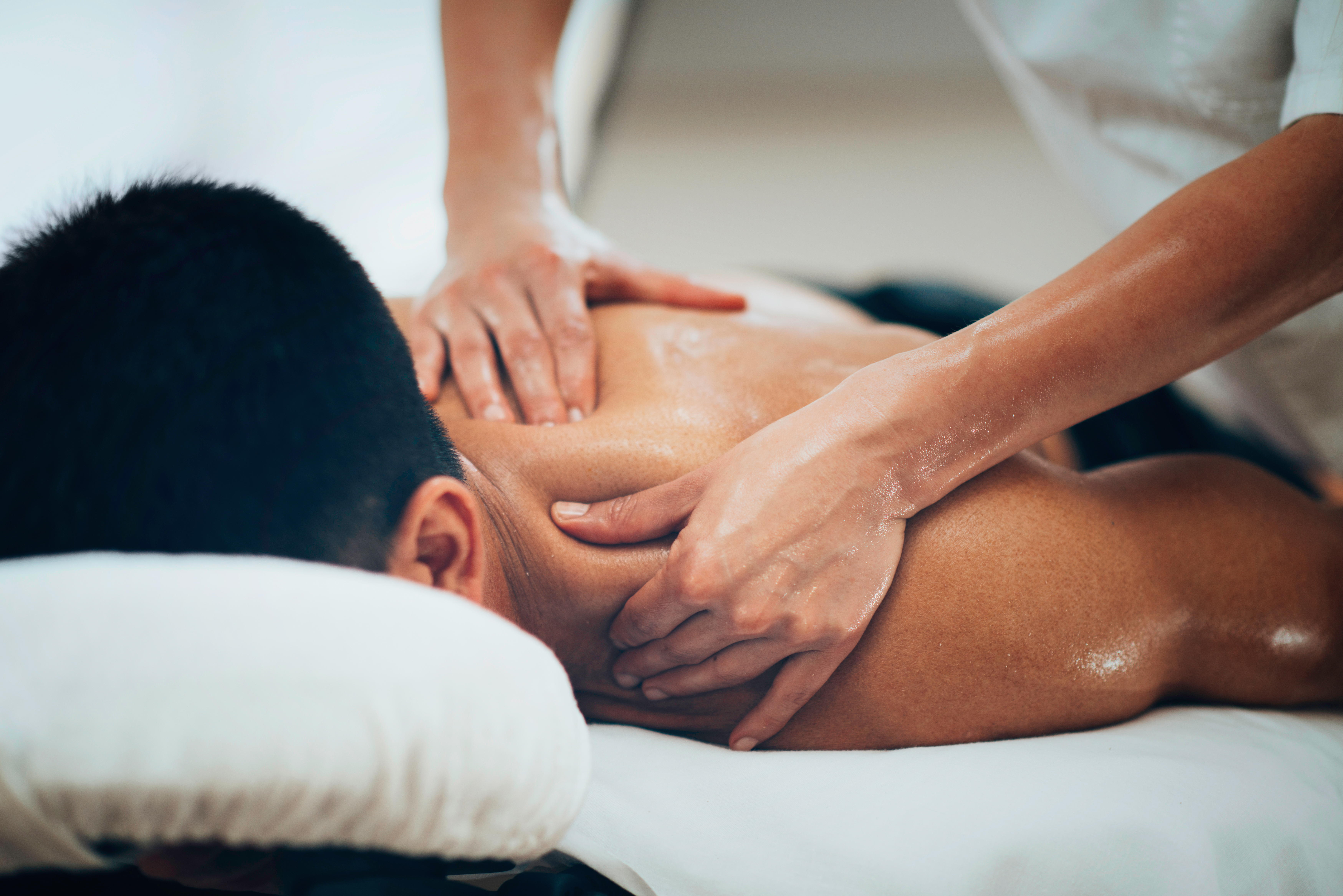 Sports massage deployed by physical therapist massaging shoulder region