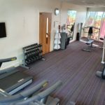 Indoor gymnasium with treadmills, bikes and weights